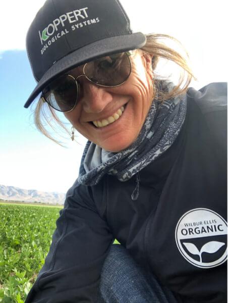 Gina Bella Colfer of Wilbur Ellis in a Salinas Valley field